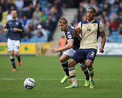 Leeds United's Lee Peltier holds off Millwall's Martyn Waghorn - Photo mandatory by-line: Robin White/JMP - Tel: Mobile: 07966 386802 28/09/2013 - SPORT - FOOTBALL - The Den - Millwall - Millwall V Leeds United - Sky Bet Championship