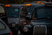 Black London cabs protest about their being banned from City road junctions, on 18th January 2017, in Parliament Square, London England.