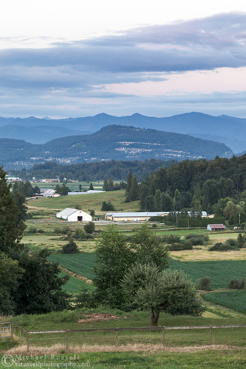 Abbotsford farmland and buildings with Sumas Mountain in the background.  Photographed in Abbotsford, British Columbia, Canada.