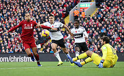 Liverpool's Virgil van Dijk, Fulham's Aleksandar Mitrovic, Fulham's Ryan Sessegnon and Liverpool goalkeeper Alisson Becker in action during the Premier League match at Anfield, Liverpool.