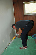 Hugh Goglin finishes my drywall repair project. He's doing the final texturing in the bike room.