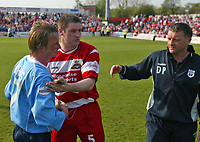 Photo. Andrew Unwin<br />Doncaster Rovers v York, Nationwide League Division Three, Earth Stadium, Belle Vue, Doncaster 24/04/2004.<br />York's player-manager, Chris Brass, is commiserated by Doncaster's John Doolan (c) and manager, Dave Penney (r).