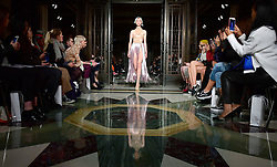 Models on the catwalk during the Mark Fast London Fashion Week SS18 show held at Freemasons Hall, London.