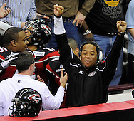 Cleveland coordinator Willie Wood Jr. raises his arms in victory     during the Gladiators' 61-48 win in their Arena Football League debut on March 3, 2008 at Quicken Loans Arena in  Cleveland against visiting New York Dragons.