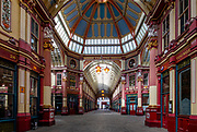 City of London England UK March 2021<br />Leadenhal Market empty during Covid 19 Lockdown March 2021<br />Leadenhall Market. Leadenhall Market is a covered market in London, located on Gracechurch Street but with vehicular access also available via Whittington Avenue to the north and Lime Street to the south and east, and additional pedestrian access via a number of narrow passageways. The ornate roof structure, painted green, maroon and cream, and cobbled floors of the current structure, designed in 1881 by Sir Horace Jones (who was also the architect of Billingsgate and Smithfield Markets), make Leadenhall Market a tourist attraction.[3]<br /><br />The main entrance to the market is on Gracechurch Street. The double height entrance is flanked by tall, narrow gabled red brick and Portland stone blocks in a 17th-century Dutch style. The adjacent buildings to the south have a continuous retail frontage which is punctuated by narrow entrances to pedestrian ways into the market.