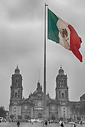 """The Zocalo in Mexico City is one of the largest squares in the world, approximately 787ft x 787 ft.  Right in the middle stands a flag pole with a large flag pictured here.  Behind is the Cathedral and to the right, not pictured, is the National Palace where the President declares """"Viva Mexico"""" every year on their independence."""