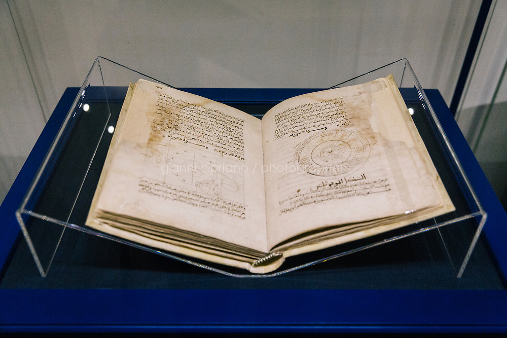 """FLORENCE, ITALY - 28 JULY 2018: """"Kitab al-Asrar fi nata'ij al-afkar"""" (Book of secrets in the results of ideas), copied by Ahmad ibn Khalaf al-Muradi, is seen here in the exhibition """"Islamic Art and Florence from the Medici to the 20th century"""" at the Uffizi Gallery in Florence, Italy, on July 28th 2018.<br /> <br /> """"Islamic Art and Florence from the Medici to the 20th century"""", curated by Giovanni Curatola and organised by the Uffizi  offers visitors the opportunity to discover the knowledge, exchange, dialogue and mutual influence that existed between the arts of East and West. The exhibition illustrates the extremely important role that Florence played in interfaith and intercultural exchange between the 15th and the early 20th centuries.<br /> <br /> According to Eike Schmidt, the Director of the Gallerie degli Uffizi, """"the exhibition not only highlights the interest in Islamic culture that was strongly rooted in Medici collectintg and that continued well into the modern era, but it also testifies to the unprejudiced aesthetic fascination with the Orient that has always permeated European art. At the same time, it draws our attention to the crucial importance of trade, but primarily of intellectual and human exchange, in the Mediterranean basin and beyond as a means of enrichment and of peace""""."""