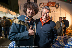 "Kaichiroh ""Kross""  Kurosu of Cherry's Company with Mooneyes owner Shige Suganuma at the Mooneyes Yokohama Hot Rod & Custom Show after-party at Mooneyes headquarters. Yokohama, Japan. December 7, 2015.  Photography ©2015 Michael Lichter."