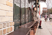 A young Japanese lady waiting outside a restaurant in Sakae, the trendy shopping district of Nagoya city.