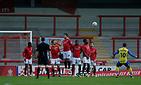 Football - 2020 / 2021 Emirates FA Cup - Round Two: Morecambe vs. Solihull Moors<br /> <br /> Aaron Wildig of Morecambe fires in a free kick over the Solihull Moors defensive wall, at the Mazuma Stadium.<br /> <br /> COLORSPORT/ALAN MARTIN
