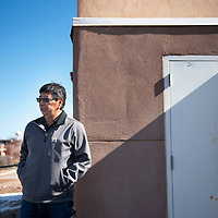 Jarvis Chopito, Zuni Public School District maintenance supervisor stands in the backyard of a home at the Zuni High Teacherage Thursday, Jan. 30. Chopito talks about issues that he's seen in these homes built in 2002 including overhead pipes that can freeze in winter and settling issues.