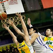 Anadolu Efes's Kerem Gonlum (C) during their Turkish Basketball League match Anadolu Efes between Olin Edirne at the Ayhan Sahenk Arena in Istanbul, Turkey on Sunday, 17 March, 2013. Photo by TURKPIX