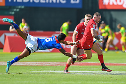 Cameron Lewis of Wales evades the tackle of John Vaili of Samoa <br /> <br /> Photographer Craig Thomas/Replay Images<br /> <br /> World Rugby HSBC World Sevens Series - Day 2 - Friday 6rd December 2019 - Sevens Stadium - Dubai<br /> <br /> World Copyright © Replay Images . All rights reserved. info@replayimages.co.uk - http://replayimages.co.uk