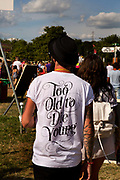 """""""Too old to die young"""" t-shirt worn at the Glastonbury Festival. <br /> Glastonbury Festival is the largest greenfield festival in the world, and is now attended by around 175,000 people. It's a five-day music festival that takes place near Pilton, Somerset, England. In addition to contemporary music, the festival hosts dance, comedy, theatre, circus, cabaret, and other arts. It is organised by Michael Eavis on his own land, Worthy Farm in Pilton. Leading pop and rock artists have headlined, alongside thousands of others appearing on smaller stages and performance areas."""