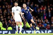 Scotland forward Steven Fletcher (9) (Sheffield Wednesday) and Omri Ben Harush (20) (Lokeren)of Israel during the UEFA Nations League match between Scotland and Israel at Hampden Park, Glasgow, United Kingdom on 20 November 2018.
