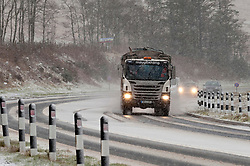 © Licensed to London News Pictures. 12/03/2020. Brecon Beacons, Powys, Wales, UK.  A truck negotiates the A470 road in wintry conditions in the Brecon Beacons National Park, Powys, Wales, UK. Photo credit: Graham M. Lawrence/LNP