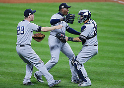 October 11, 2017 - Cleveland, OH, USA - New York Yankees' pitcher Aroldis Chapman, middle, celebrates the final out, a strike out of the Indians' Austin Jackson, with third baseman Todd Frazier, left, and Gary Sanchez, right, that concluded a 5-2 win against the Indians in Game 5 of the American League Division Series, Wenesday, Oct. 11, 2017, at Progressive Field in Cleveland. (Credit Image: © Leah Klafczynski/TNS via ZUMA Wire)