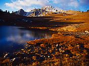 Echo Peak reflected in alpine lake, Hilgard Basin, Madison Range, Lee Matcalf Wilderness, Montana.