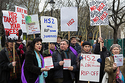 London, UK. 12th January, 2018. Labour London Assembly member Andrew Dismore (c) joins local residents and environmental campaigners in protesting against the planned felling of mature London Plane, Red Oak, Common Whitebeam, Common Lime and Wild Service trees in Euston Square Gardens to make way for temporary sites for construction vehicles and a displaced taxi rank as part of preparations for the HS2 high-speed rail line.