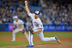 March 29, 2018 - Toronto, ON, U.S. - TORONTO, ON - MARCH 29: Toronto Blue Jays Right hand Pitcher Tyler Clippard (36) pieces late in the MLB season-opener game between the New York Yankees and the Toronto Blue Jays at Rogers Centre in Toronto, ON., Canada March 29, 2018. (Photo by Jeff Chevrier/Icon Sportswire) (Credit Image: © Jeff Chevrier/Icon SMI via ZUMA Press)