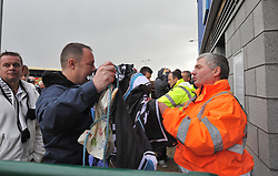 Swansea City fans gets Searched as he comes into the ground.- Photo mandatory by-line: Alex James/JMP - Tel: Mobile: 07966 386802 03/11/2013 - SPORT - FOOTBALL - The Cardiff City Stadium - Cardiff - Cardiff City v Swansea City - Barclays Premier League