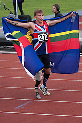 Lee Valley Athletic Centre, London, September 11th 2014. Great Britain's Andrew Grant celebrates his victory in the 1500m Men Ambulant IT1 final, cloaked in the flag of his regiment.