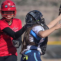 032515       Cable Hoover<br /> <br /> St. Michael Cardinal Sydney Terry (14) squeezes past Window Rock Scout catcher Danesha Henry (15) to tag home Wednesday at Window Rock High School.