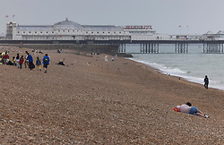 © Licensed to London News Pictures. 24/07/2021. Brighton, UK. Few people on the beach at Brighton on the south coast. The weather has changed for most places today with rain and lightning forecast. Photo credit: Peter Macdiarmid/LNP