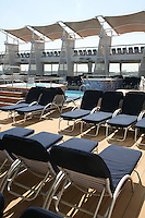 Celebrity Eclipse interior photos..Deck chairs by the pool.
