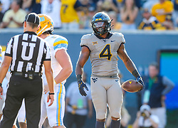 Sep 11, 2021; Morgantown, West Virginia, USA; West Virginia Mountaineers running back Leddie Brown (4) runs for a touchdown during the first quarter against the Long Island Sharks at Mountaineer Field at Milan Puskar Stadium. Mandatory Credit: Ben Queen-USA TODAY Sports