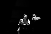 """Amateur Chessboxers Daniel Biman (left) and Mohamad Khadijah are engaged in a round of chess during a chessboxing match at the Intellectual Fight Club in Berlin, Germany on the 15th of December 2017. <br /> Chessboxing is a literal combination of chess and boxing in a single match, demanding the players to quickly shift between mental and physical skills. The battle consists of 11 alternating rounds of chess and boxing, each lasting for 3 minutes. A game is won by checkmate, knockout or the judge's decision. <br /> The sport first got conceived of by the Slovak Bosnian comic book creator Enki Bilal, who introduced it in his futuristic graphic novel """"Cold Equator"""". Inspired by the book Dutch artist Iepe Rubingh staged the first fight in Amsterdam in 2003, which he himself fought and won. After that Iepe moved to Berlin and proceeded to found chessboxing-global.com, an organisation that strives to make the new sport popular worldwide."""