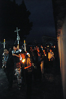 """Mexico, Oaxaca, Teotitlan del Valle, April 21-22, 2011. True faith suffuses every aspect of Teotitlan del Valle's painstaking recreation of the last hours of Jesus, from Thursday's afternoon's Last Supper through to a night vigil at a jail cell after his arrest. Village elders play the parts of the twelve apostles, and the town's devout fill the church for mass and communion, for the ritual washing of the disciple's feet, and for multiple gatherings which mark the hours. Good Friday dawns with music, scripture, and a solemn procession of Christ, the Virgin Mary and the town's own radiant""""Virgen Dolorosa"""" through the streets."""