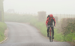 © Licensed to London News Pictures. 18/04/2019.<br /> Swanley,UK. Foggy Kent weather for this cyclist on   Crockenhill Lane this morning in Swanley, Kent. Photo credit: Grant Falvey/LNP