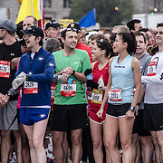 Some of the runners in the Red Wave get ready to start at the 2012 Cherry Blossom 10-Miler, the 40th running of the race that is run every spring in Washington DC to coincide with the National Cherry Blossom Festival. The course starts near the Washington Monument, heads over Memorial Bridge and back, goes up under the Kennedy Center, around the Tidal Basin and past the Jefferson Memorial, and then does a loop around Hains Point back to the finish near the Washington Monument.