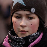 """Hirvas Salmi, FINLAND.  With flecks of mud and reindeer blood across her cheeks, Annirauna Triumf, 16, corrals her reindeer during an 11 hour day.  She lives in Norway with her mother but comes to Finland for this """"reindeer school"""" five times a year.  This is a way that youth straddle both the modern day lives while retaining age-old traditions."""
