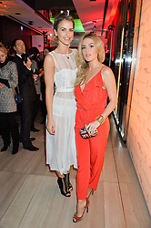 Left to right, VOGUE WILLIAMS and TALLIA STORM at the launch of the new Ferrari 488 Spider held at Watches of Switzerland, 155 Regent Street, London on 25th February 2016.