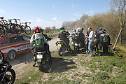 France, Sunday 12th April 2015: Photographers and their motorbikes head off from the Pont Gibus section of pave during the 2015 edition of the Paris Roubaix elite men's cycle race.