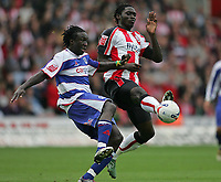 Photo: Lee Earle.<br /> Southampton v Queens Park Rangers. Coca Cola Championship. 30/09/2006. QPR's Damion Stewart (L) battles with Kenwyne Jones.