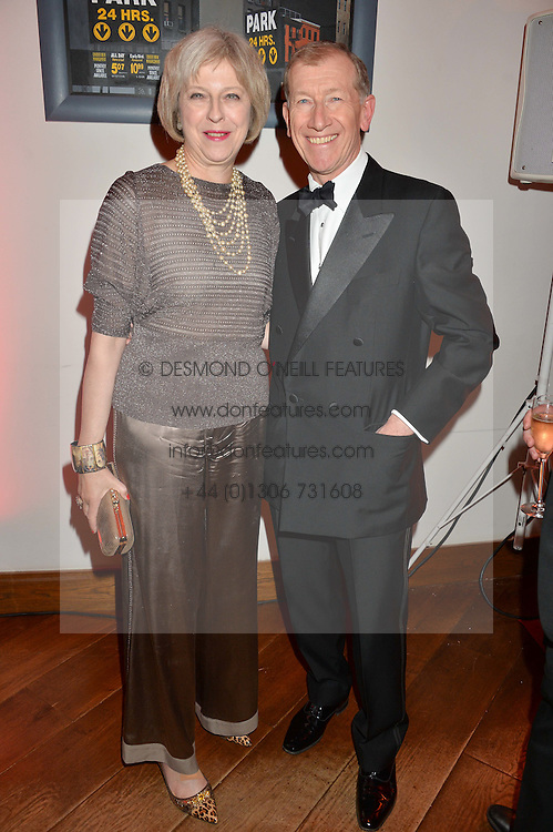 The Home Secretary THERESA MAY MP and her husband PHILIP MAY at a party to celebrate the 21st anniversary of The Roar Group hosted by Jonathan Shalit held at Avenue, 9 St.James's Street, London on 21st September 2015.