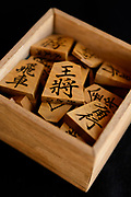 """A set of """"moriage-goma"""" raised letter shogi playing pieces. Nakajima Seikichi Shoten, Tendo, Yamagata Prefecture, Japan, February 19, 2018. The city of Tendo in Yamagata Prefecture is famous for its shogi (Japanese chess) playing pieces. Production started early in the 19th century and Tendo still produces over 95% of the Shogi pieces made in Japan."""