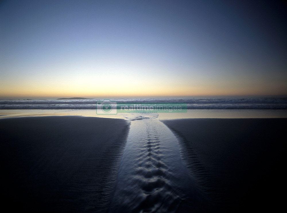 Water flowing out to sea at dusk, Camps Bay, Cape Town, South Africa (Credit Image: © Axiom/ZUMApress.com)
