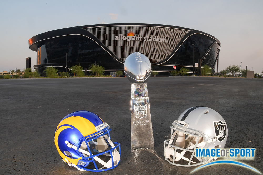 The Vince Lombardi Trophy is seen with Los Angeles Rams and Las Vegas Raiders helmets outside of of Allegiant Stadium, Monday, Sept. 14, 2020, in Las Vegas. (Dylan Stewart/Image of Sport)