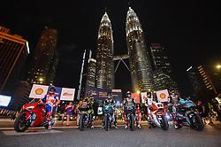 October 31, 2018 - Kuala Lumpur, Malaysia - From left Italian MotoGP rider Danilo Petrucci of Pramac Ducati Team, Malaysian MotoGP rider Hafizh Syahrin of Monster Yamaha Tech 3, Malaysian Moto3 rider Adam Norrodin of SIC Racing Team, Japanese Moto3 rider Ayumu Sasaki of SIC Racing Team, Malaysian Moto2 rider Khairul Idham Pawi of Idemitsu Honda Team Asia and Finnish Moto2 rider Niki Tuuli of SIC Racing Team pose with their bikes in front of the Malaysia's landmark Kuala Lumpur twin tower in Kuala Lumpur, during a MotoGP pre-event ahead of Malaysian Grand Prix, on October 31, 2018. (Credit Image: © Zahim Mohd/NurPhoto via ZUMA Press)