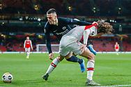 Eintracht Frankfurt midfielder Filip Kostic (10) battles for possession with Arsenal midfielder Mattéo Guendouzi (29) during the Europa League match between Arsenal and Eintracht Frankfurt at the Emirates Stadium, London, England on 28 November 2019.