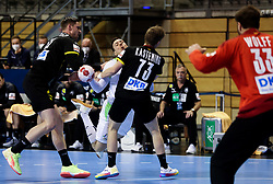 Rok Ovnicek of Slovenia vs Timo Kastening of Germany during handball match between National Teams of Germany and Slovenia at Day 2 of IHF Men's Tokyo Olympic  Qualification tournament, on March 13, 2021 in Max-Schmeling-Halle, Berlin, Germany. Photo by Vid Ponikvar / Sportida