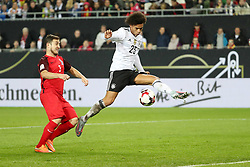 KAISERSLAUTERN, Oct. 9, 2017  Leroy Sane (R) of Germany shoots during the FIFA 2018 World Cup Qualifiers Group C match between Germany and Azerbaijan at Fritz Walter Stadium in Kaiserslautern, Germany, on Oct. 8, 2017. Germany won 5-1. (Credit Image: © Ulrich Hufnagel/Xinhua via ZUMA Wire)