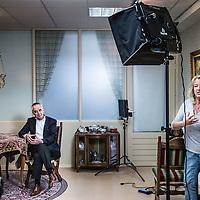 Nederland, Den Haag, 20 maart 2016.<br /> tv-opnames voor DementieTv in kamers die in jaren 50-stijl zijn ingericht (Herinneringsmuseum). DementieTv wil vanaf dit najaar dagvullende programma's verzorgen die zijn afgestemd op de verstandelijke en emotionele vermogens/behoeften van mensen met (vergevorderde) dementie.<br /> <br /> Op de foto: Tie van der Horst Regisseur, instrueert de cameraman. Figurant en verteller Fons Fluitman luistert aandachtig toe.<br /> <br /> TV recordings for DementieTv in rooms decorated in 50 's style ( Memorial Museum). DementieTv will provide full-day programs this fall that are tailored to the intellectual and emotional capacities / needs of people with ( advanced ) dementia.<br /> On the photo : Tie van der Horst, director, instructing the cameraman. Figurant and narrator Fons Fluitman listening attentively .<br /> Foto: Jean-Pierre Jans