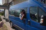 Guy Davis pokes his head out the tour van's window as Kultur Shock leaves Banja Luka, Bosnia and Herzegovina en route to Belgrade, Serbia...