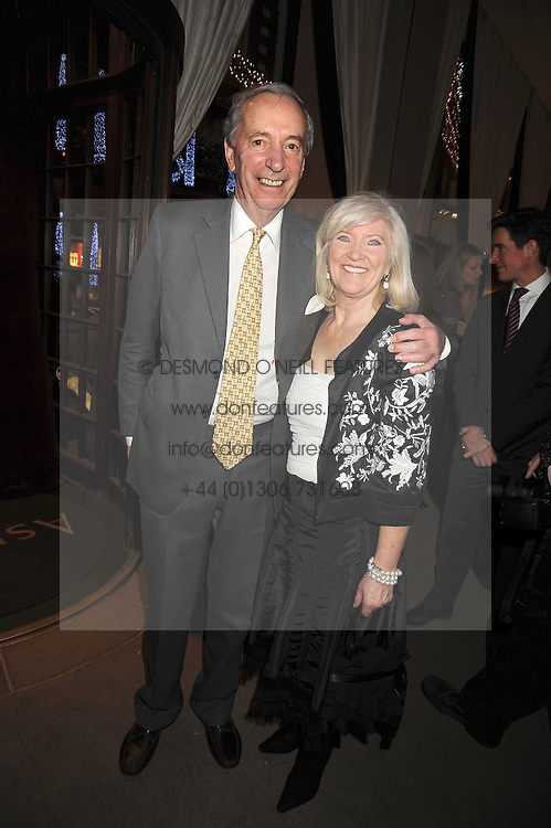 LIBBY REEVES PURDY and MR JOHN CHALK at the Asprey Winter Wonderland party held at their store, 167 New Bond Street, London on 4th December 2008.