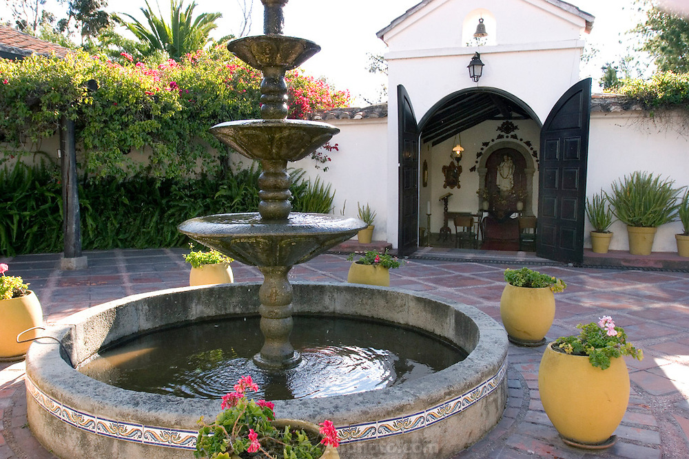 Courtyard fountain with private chapel at Pablo Corral Vega's farm house two hours outside Quito, Ecuador.